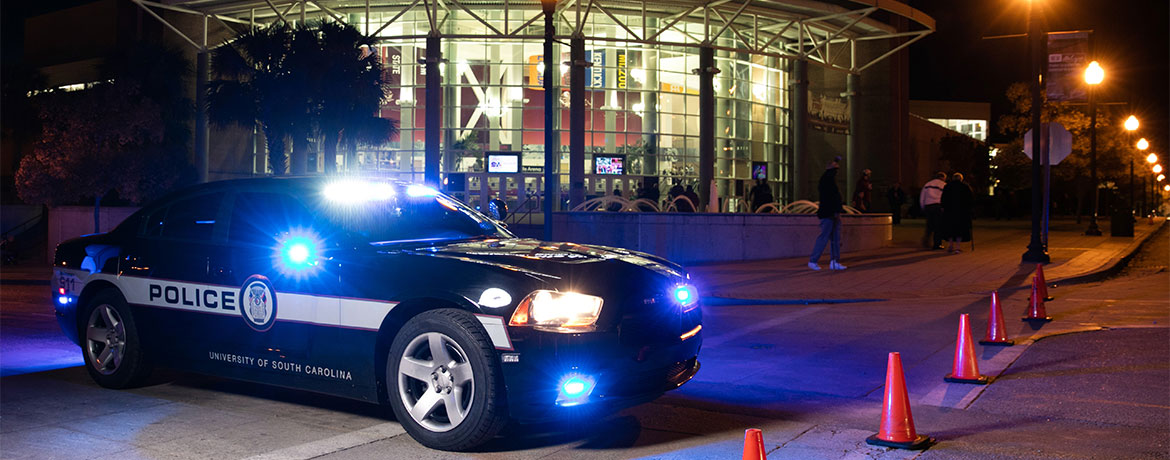 UofSC police car in front of Colonial Life Arena