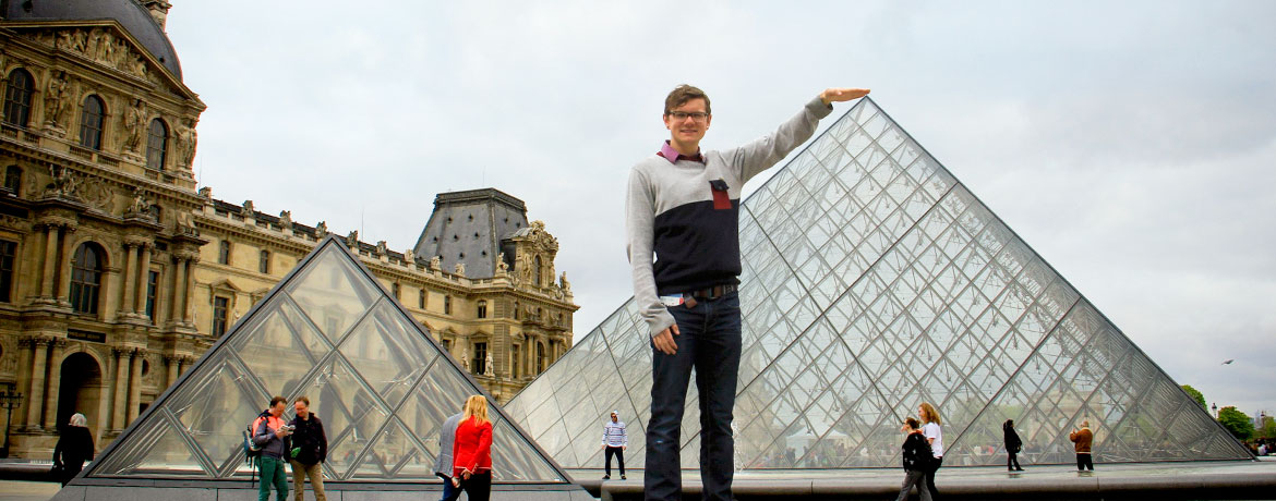 student posing outside the Louvre
