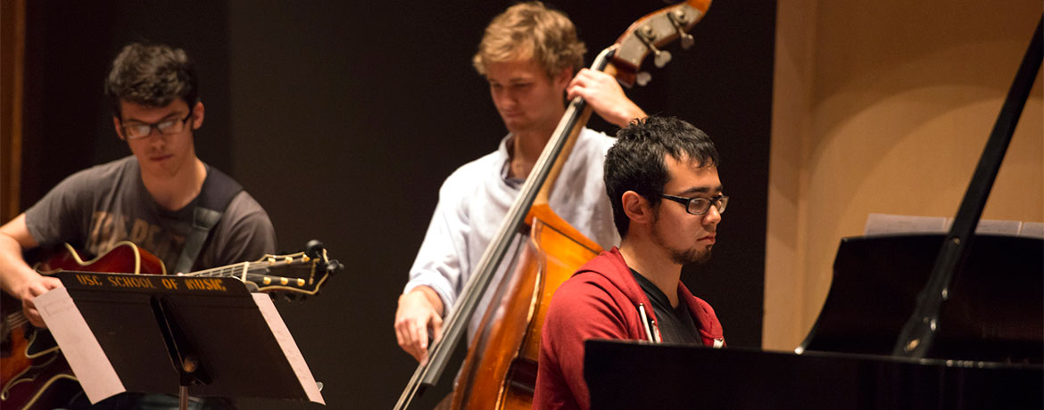 jazz trio performing on stage at the School of Music Recital Hall