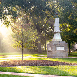 The Maxcy monument stands right of center on the historic Horseshoe, which is green with summer